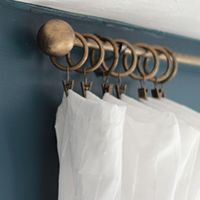 Make DIY curtain rods that look like antique brass -- plus TONS of other creative DIY curtain rod ideas!