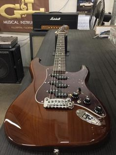 G&L Musical Instruments Comanche in Whiskey over swamp ash, tortoise guard, rosewood board, Clear Satin neck finish, matching headstock.
