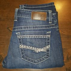 BKE Jeans by Buckle.  Payton These are BKE Jeans by Buckle.  The style is Payton.  The are size 27L with a lenght of about 32 1/2.  They have the upgraded gold thread against the dark demon that looks awesome.  Classic BKE Look at an affordable Price. BKE Jeans Straight Leg