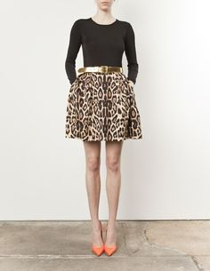 Animal print, black & a pop of coral. The skirt is a little short for me but this is classic with a twist done well.