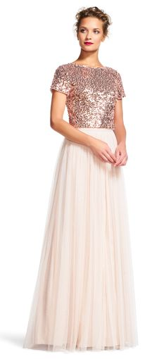 The perfect amount of glamour is easily attained in this formal gown set. Featuring a cropped, short sleeve sequin top with a scoop neckline and deep scoop back and a simple pleated chiffon skirt, this evening dress set is subtly trendy. Skip the accessories and keep it simple with a nude heel and understated handbag when styling this dress set.