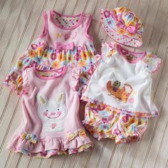 Adorable artist designed collection for your little girl from Hallmark Baby. Summer sundresses, rompers and body suits - perfect for summer play