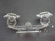 A vintage small Swarovski crystal, pin style, double candlestick, candleholder.  Measures six and a half inches long by two and a quarter inches tall.