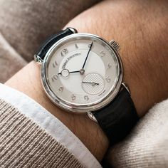 The Urban Jürgensen 1140 in platinum. Brushed dial and bombé Arabic numerals. Available now.