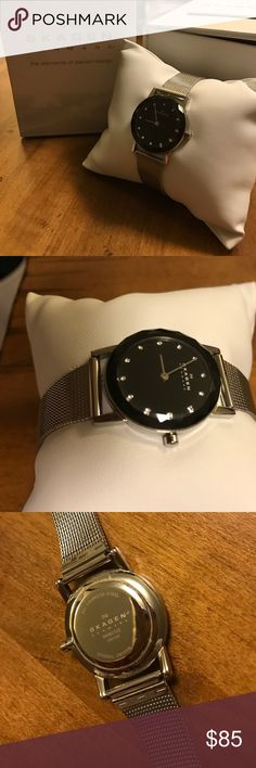 Skagen Silver w/ Black Face Watch #SKW2133 Skagen Silver w/ Black Face Watch #SKW2133, Bought At Macy's, Battery Not Working, All Stainless Steel, Mineral Crystal, You Can Find Additional Details By Searching The Sku Number On The Intranet (Couldn't Fit Them All In This Listing), Previously Owned, No Scratches or Marks on Face of Watch, One Broken Link (pictured on bottom left of last picture). Scratches In Metal On Closure From Normal Wear. This Watch Is No Longer On Sale. Beautiful Look…