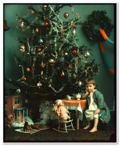 Girl by Christmas tree     H.B. Wills, American, b. 1874     December 10, 1914     color plate, assembly (two-color Kodachrome) process     Image: 24.1 x 19 cm
