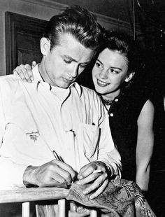 Dean, with blood on his shirt, signs Natalie Wood's suede autograph jacket. He was her 100th co-star to sign. Wood's mother later burned the signatures with a hot needle for posterity.