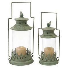 Set of two metal candle lanterns with glass shades and bird finials.   Product: Small and large lanternConstruction Material: Metal and glassColor: Copper verdigrisFeatures: Bird finialsAccommodates: (1) Candle each - not includedDimensions: 17 H x 7.25 Diameter (large)