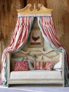 Maritza's Rooster Daybed Hand Made One of a Kind all wood Daybed with black painted garland. Red ticking fabric curtain with hand sewn smocking pleat. Inner turquoise curtain in  burlap fabric.  Rooster Americana framed Print Includes all pillows {Approx 7inches high 5-1/2 inches long}
