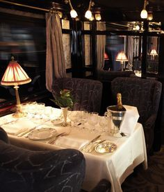 Orient Express ~ 'Lalique' dinning car at night. The train pushes on into the night. They will be in Vienna, Austria in the morning for sight seeing. But one passenger may not survive the night. By Train, Train Tracks, Train Rides, Orient Express Train, Simplon Orient Express, Rail Car, Old Trains, Train Station, Luxury Travel