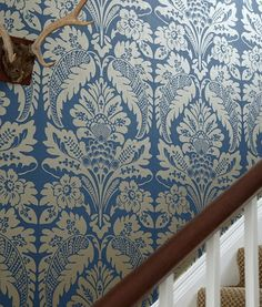 What about this?  Wilton Wallpaper A block print style damask wallpaper in gilver on amethyst.