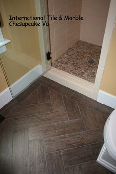 Wood grain porcelain floor tile- herringbone layout. - Master Bedroom and bath