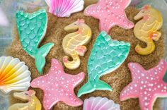 Lay seashell cookies on a bed of brown sugar to look like sand