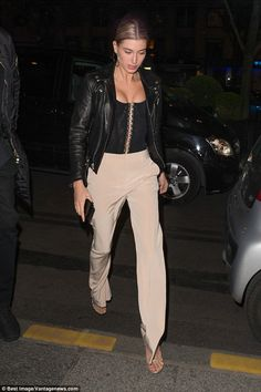Stylish: Hailey Baldwin looked sexy in a black corset top as she returned to her hotel in Paris on Sunday