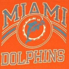 Vintage 1980s Miami Dolphins Champion brand T-shirt. Shirt has some straining near waist - see photos