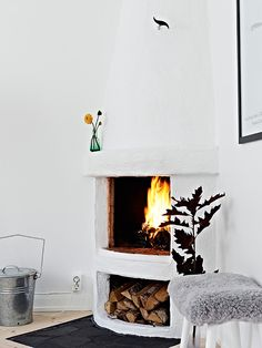 fireplace. love the idea. too much white for my taste, i'd make the base of the fireplace brick or with black marble, and have dark wood floors with maybe a rich red color on the walls. or maybe a nice brown.