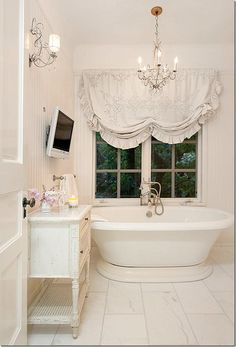 Jessica Simpson's shabby chic bathroom decorated by Rachel Ashwell I want a flat screen TV in my bathroom!