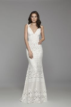Tara Keely Bridal Style 2760 - Ivory Guipure banded lace trumpet gown, plunging halter neckline with Venise lace strap detail, low back and sweep train.