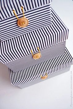 Storage Boxes=Shoe Boxes covered with Fabric and a Button