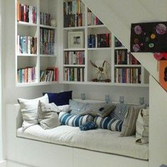 Small But Comfy Reading Nook Under The Stairs , Creative Interior Design Under Stairs Ideas In Interior Category