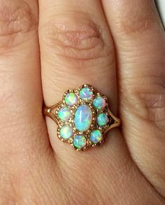 Welcome to my shop of Tiny Treasures! Here we have a Vintage circa 1930s FIRE Opal cluster cocktail ring...NOW ON SALE!! Absolutely stunning this 9ct Yellow gold ring hails from England. There is a full Birmingham 9ct gold assay hallmark on the inside circumference of the shank. This appealing Art Deco statement ring is an ample size 7 3/4 (7.75) and could easily be resized by any local trustworth jeweler. The head of ring is curved and measures 15.0mm x 12.5mm. It is encrusted with oval...