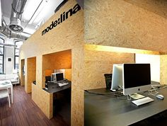 Simple plywood offices with a hidden loft