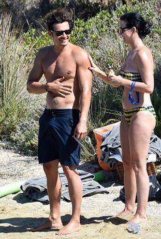 Katy Perry's boyfriend Orlando Bloom frolics the beach naked, some butt on display