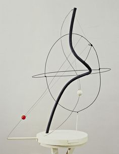 """4. A Universe  Alexander Calder (1898–1976)    1934. Painted iron pipe, steel wire, motor, and wood with string, Overall: 40 1/2 x 30"""" (102.9 x 76.2 cm). Gift of Abby Aldrich Rockefeller (by exchange). © 2012 Calder Foundation, New York / Artists Rights Society (ARS), New York"""