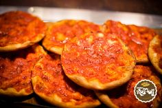 Roud Red Pizza. It has the same dough of the white one, but it is spiced with raw tomatoes, oregano and biologic wheat salt. Crispy and very thin, it is very good both warm and cold.