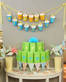 free printable party cup garland + game.  To play game, toss Ping-Pong balls into cups, aiming at the starburst bull's-eyes. When a player gets a ball in a cup, they win the prize in the corresponding lettered bag.  {Martha Stewart}