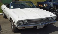 My soon to be wife had this great 1968 Chevelle convertible.  It was just like this car, white with a faded dark blue top.  The seats were blue vinyl, but it really was a nice car. I eventually painted it dark blue and put a new roof on, but it was great little car. I sold it in a grocery store parking lot in El Paso to a lady who always wanted a soft top.  Years later, I saw it in a car show.