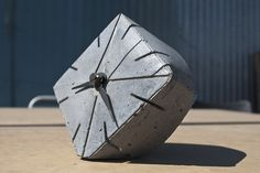 Clock made from bottom of milk carton    made with ShapeCrete : the Shape-able Concrete Mix for diy, craft, art, make / maker projects, pros and kids 12+