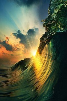 Rays of sunlight reflecting on a spectacular ocean wave.
