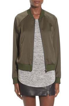 Swooning over this trendy bomber jacket with a streamlined silhouette and sporty sleeves. This wear-with-anything jacket complements put-together looks effortlessly.