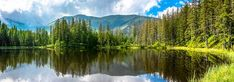 Mountain lake in the forest, Tatra Mountains, National Park in Poland, summer landscape