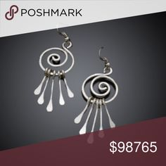 "SOLD OUT!🔰Hammered Silver Tribal Earrings 🔰Atlanta Artisan Handcrafted Stunning Hammered Silver Plated Tribal Scroll Earrings.  These Beauties are Amazing! The Metalwork is Pure Artistry! The hammering rivets catch the light and truly SHINE! 💎 Approximately a 2.5"" Drop🔰 Help support local artists and set off any outfit all at the same time!🔰 Denim, Boots, & Bling  Jewelry Earrings"