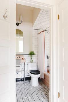 pink sink and bathtub in a recently renovation vintage-style bathroom in Chicago | via Yellow Brick Home Pink Bathroom Tiles, Bathroom Flooring, Modern Bathroom, Bathrooms, Small Bathroom, Plumbing Installation, Tile Installation, The Tile Shop, Budget Bathroom
