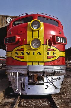 "On the morning of October 22, 1972, Santa Fe F7A 311L takes a well deserved rest after completing its run on the point of Amtrak #3, the westbound ""Southwest Limited,"" from Chicago to LA. Photo by RockAndRail."