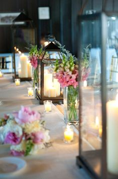 so pretty! love all the tealights and the lanterns / pink+green floral. pretty for outdoor wedding!