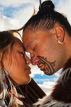 Maori Moko | Maori man with ta moko (facial tattoo) and woman doing hongi ...