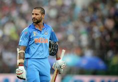 Asia Cup Team Sri Lanka defeat India in match Indian cricketer Shikhar Dhawan walks off the field after being dismissed by Sri Lankan bowler Ajantha Mendis. Asia Cup, Shikhar Dhawan, Blue Army, Republic Day, Sri Lanka, World Cup, Cricket, Squad, Indian