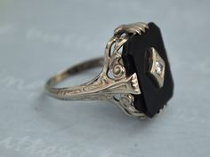 VINTAGE FIND, Art Deco 14k white gold ring with black onyx and diamond size 4.75. $285.00, via Etsy.