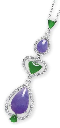 A JADEITE AND DIAMOND PENDENT NECKLACE.