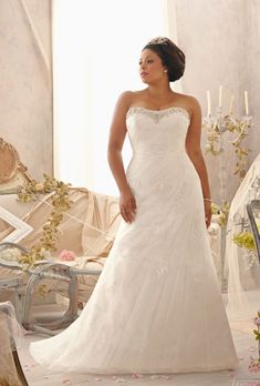 Brides.com: Designer Plus-Size Wedding Dresses We Love. Style 3152, embroidered lace appliqués on net over Chantilly lace with a corset back, $1,150, Mori Lee See more Mori Lee wedding dresses.