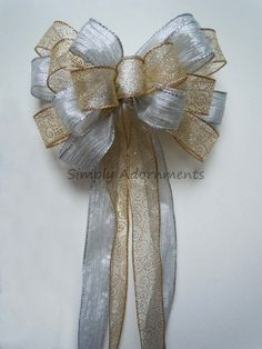 Hey, I found this really awesome Etsy listing at https://www.etsy.com/listing/169466921/silver-gold-winter-wedding-pew-bows