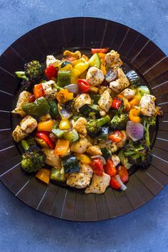Healthy and flavorful. Oven roasted chicken breasts and rainbow veggies are tender & juicy and ready in 15 minutes.  This