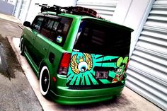 green Scion xB with decals