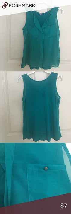 Teal Sleeveless Tank Worn max 3 times. The front is slightly sheer- see photo with my hand behind it. But the back is cotton(not sheer). Charlotte Russe Tops Tank Tops