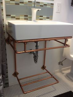 Copper wall-mounted bathroom sink stand with towel rack. $500.00, via Etsy.