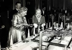 November 1962, English crime writer Agatha Christie, left, cuts the cake at London's Savoy Hotel to mark the 10th anniversary of her play 'The Mousetrap'